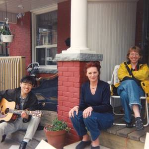 Nothing beats a yard sale at the Alianaks', especially when it's raising money for a show. Here Sean Baek serenades the crack sales team of Sheila Alianak and Glenda MacFarlane. (2008)