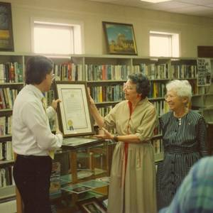 Lee Secrest (L) and Dorothy Brooks (far R) in the act of commemorating Walter R. Brooks with a display at the Roxbury, New York library. Brooks was the author of the Freddy the Pig series, which sold over a million copies in the 40s and 50s, and remains in print today. Dorothy, now deceased, was Walter's wonderfully spirited widow and she was tickled pink that her husband's life work was being promoted by Friends of Freddy.
