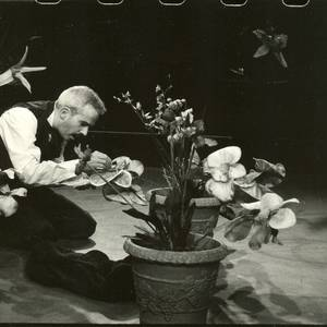 Patrick Galligan doing a little gardening in the Pea Green production of Orchidelirium, Factory Theatre, Winter 2003. Sue Miner directed.
