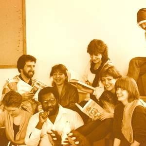 The staff of the Playwrights Union, circa 1988. There are at least three playwrights in this picture, including David Demchuk (Santa's elf) and Glenda MacFarlane (foreground). Gay Revell was the Executive Director.
